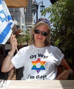 Woman wearing t-shirt that reads 'Oy Vey! I'm gay!