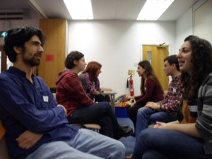 Rainbow Jews volunteers seated, doing role play